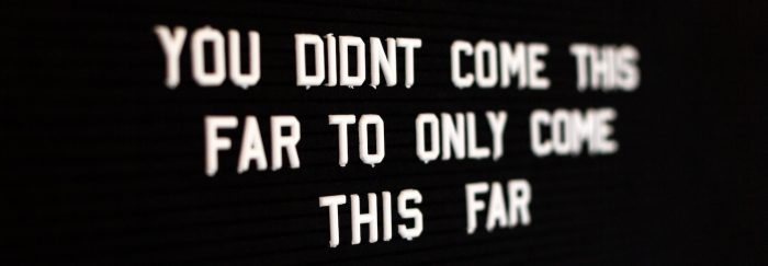 Motivational phrase on black background